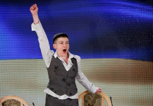 Ukrainian pilot Nadezhda Savchenko, who was freed from a Russian jail, shouts patriotic slogans as she leaves her news conference in Kyiv, Ukraine, Friday, May 27, 2016. Savchenko who came home on Wednesday after two years in Russian custody says she would run for president if that's what Ukrainians desire. (AP Photo/Sergei Chuzavkov)