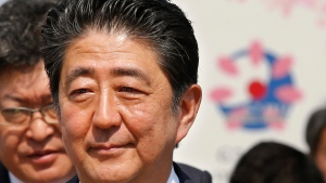 Japanese Prime Minister Shinzo Abe leaves after a press conference of the Group of Seven Summit in Shima, central Japan, Friday, May 27, 2016. (AP Photo/Shizuo Kambayashi)