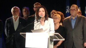 Martine Ouellet is flanked by supporters as she declares her bid to become PQ leader on May 27, 2016 (Derek Conlon/CTV Montreal)