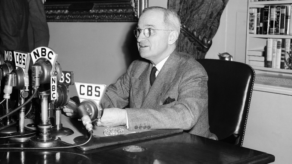 U.S. President Harry S. Truman, talks in front of microphones in the White House in Washington, D.C., April 25, 1945. (AP)