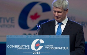 Former prime minister Stephen Harper pauses for a moment as he addresses the Conservative Party of Canada convention in Vancouver, Thursday, May 26, 2016. (Jonathan Hayward / THE CANADIAN PRESS)