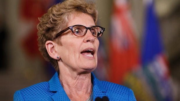 Ontario Premier Kathleen Wynne speaks during a media availability to discuss an energy innovation partnership between Alberta and Ontario at the Alberta Legislature Building in Edmonton on Thursday, May 26, 2016. (Codie McLachlan / THE CANADIAN PRESS)