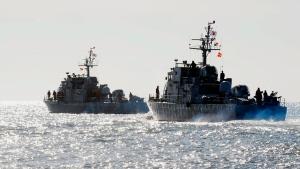 In this file photo, South Korean Navy ships sail near Yeonpyeong Island, South Korea, Tuesday, Dec. 7, 2010. (AP Photo / Yonhap, Kim hyun-tae)