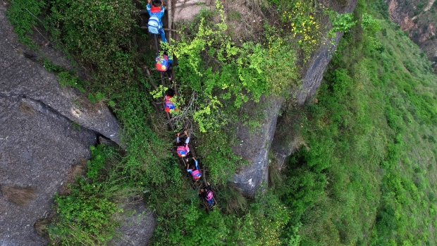 Chinese Kids Who Climb Cliffside Ladder Home Will Get