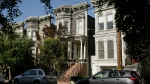 "A Victorian home, centre, made famous by the television show ""Full House"" is seen Friday, May 27, 2016, in San Francisco. (AP Photo/Eric Risberg)"