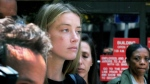 Actress Amber Heard leaves Los Angeles Superior Court court on Friday, May 27, 2016, after giving a sworn declaration that her husband Johnny Depp threw her cellphone at her during a fight Saturday, striking her cheek and eye. (AP Photo/Richard Vogel)