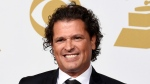 Carlos Vives poses in the press room at the 57th annual Grammy Awards in Los Angeles on Feb. 8, 2015. (Photo by Chris Pizzello/Invision/AP, File)