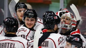 Rouyn-Noranda Huskies' goalie Chase Marchand, right, celebrates with his teammates after defeating the Red Deer Rebels in CHL Memorial Cup semi-final hockey action in Red Deer, Friday, May 27, 2016.(THE CANADIAN PRESS/Jeff McIntosh)