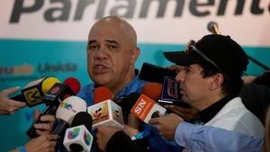 Jesus Torrealba the general secretary of the opposition alliance speaks with the media during a news conference in Caracas, Venezuela, Sunday, Dec. 6, 2015. (AP / Fernando Llano)