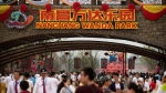 People walk through the entrance to the Nanchang Wanda Park theme park at the Wanda Cultural Tourism City in Nanchang in southeastern China's Jiangxi province, Saturday, May 28, 2016. (AP Photo / Mark Schiefelbein)