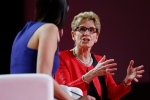 Ontario Premier Kathleen Wynne, right, speaks to Liz Plank onstage at the 2016 Liberal Biennial Convention in Winnipeg, Saturday, May 28, 2016. THE CANADIAN PRESS/John Woods
