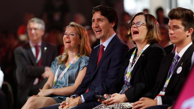 Prime Minister Justin Trudeau and Sophie Gregoire Trudeau laugh at Ontario Premier Kathleen Wynne's joke at the 2016 Liberal Biennial Convention in Winnipeg, Saturday, May 28, 2016. (THE CANADIAN PRESS / John Woods)