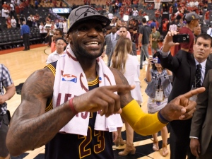 Cleveland Cavaliers forward LeBron James celebrates his team's win over the Toronto Raptor after the Eastern Conference final NBA playoff basketball game against the Cleveland Cavaliers in Toronto on Friday, May 27, 2016. (Frank Gunn / THE CANADIAN PRESS)