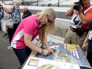 Pippa Mann, of England, signs a poster during the drivers meeting for the Indianapolis 500 auto race at Indianapolis Motor Speedway in Indianapolis, Saturday, May 28, 2016. (AP / Darron Cummings)