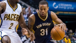 New Orleans Pelicans' Bryce Dejean-Jones (31) drives the ball around the defense of Indiana Pacers' Rodney Stuckey (2) during the first half of a preseason NBA basketball game in Indianapolis on Oct. 3, 2015. (AP Photo/Doug McSchooler, File)