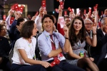 Prime Minister Justin Trudeau, Liberal President Anna Gainey, left, and Liberal Youth President Mira Ahmad vote for the new party constitution at the 2016 Liberal Biennial Convention Winnipeg Saturday, May 28, 2016. (John Woods / THE CANADIAN PRESS)