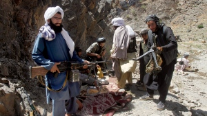 In this Friday, May 27, 2016 photo, members of a breakaway faction of the Taliban fighters prepare to guard a gathering , in Shindand district of Herat province, Afghanistan. (AP / Allauddin Khan)