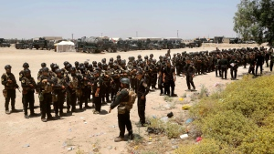 Iraq's elite counter-terrorism forces gather ahead of an operation to re-take the Islamic State-held City of Fallujah, outside Fallujah, Iraq, Sunday, May 29, 2016. (AP / Khalid Mohammed)