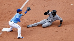 Chicago White Sox's Austin Jackson is forced out by Kansas City Royals third baseman Cheslor Cuthbert as he tried to advance to third after hitting a double during the seventh inning of a baseball game Saturday, May 28, 2016, in Kansas City, Mo. (AP / Charlie Riedel)