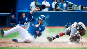 Toronto Blue Jays left fielder Michael Saunders (21) slides home safe past Boston Red Sox catcher Christian Vazquez (7) during eighth inning AL baseball action in Toronto on Saturday, May 28, 2016. THE CANADIAN PRESS/Nathan Denette