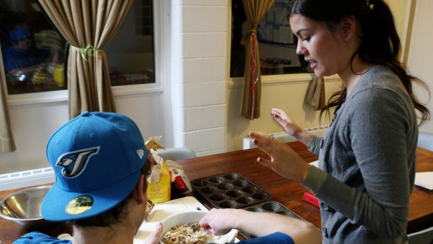 """A resident of a youth group home participates in a """"food literacy"""" cooking class in London, Ontario, Tuesday, January 10, 2012. (THE CANADIAN PRESS/Dave Chidley)"""