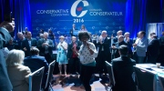 Conservative delegate Kenny Daodu dances during the closing ceremonies at the Conservative Party of Canada convention in Vancouver, Saturday, May 28, 2016. (THE CANADIAN PRESS/Jonathan Hayward)