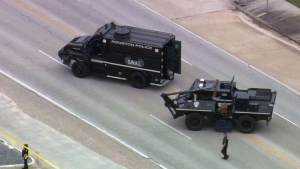 Houston police say one gunman was killed and a second was taken to a hospital.