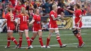Team Canada's celebrates their rugby win over Team Ireland at the HSBC Women's Sevens Series at Westhills Stadium in Langford, British Columbia, Saturday, April 16, 2016. (Chad Hipolito/The Canadian Press via AP)