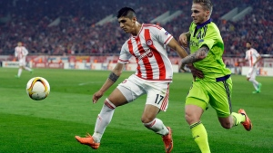 Olympiakos' Alan Pulido, left, fights for the ball with Anderlecht's Alexander Buttner during the Europa League round of 32 soccer match at the Georgios Karaiskakis stadium in the port of Piraeus, near Athens on Feb. 25, 2016. A state official says that Mexican soccer star Alan Pulido has been kidnapped in the northern border state of Tamaulipas. (AP Photo/Thanassis Stavrakis, file)