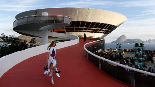 Louis Vuitton Brings Outdoor Fashion Show To Crisis Hit