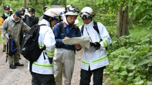 Rescuers search for a 7-year-old boy who is missing in a Japanese forest in Nanae town, on Hokkaido, the northernmost of Japan's four main islands on Monday, May 30, 2016. (Kyodo News)