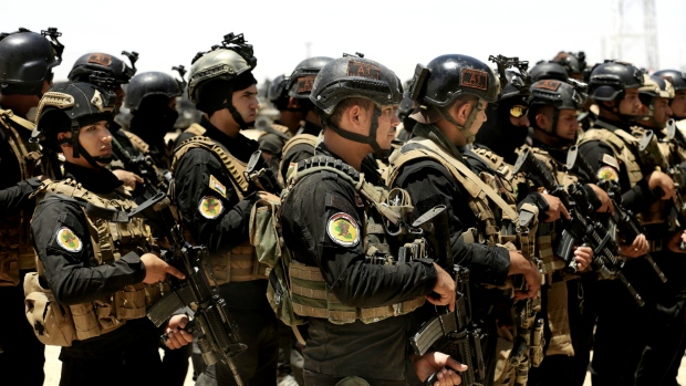 Iraq's elite counter-terrorism forces gather ahead of an operation to re-take the Islamic State-held City of Fallujah, outside Fallujah, Iraq on Sunday, May 29, 2016. (AP / Khalid Mohammed)