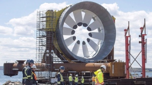 Workers walk past a turbine for the Cape Sharp Tidal project at the Pictou Shipyard in Pictou, N.S., on in a May 19, 2016, file photo. THE CANADIAN PRESS/Andrew Vaughan