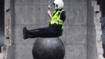"Halifax police Const. Shawn Currie is pictured in this meme based on Miley Cyrus' music video ""Wrecking Ball,"" made by Twitter user @CaptSwiggy."