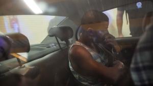 Rai de Souza, 22, a gang rape suspect is taken inside a police car to the police headquarters in Rio de Janeiro, Brazil, on Monday, May 30, 2016. (AP Photo/Felipe Dana)