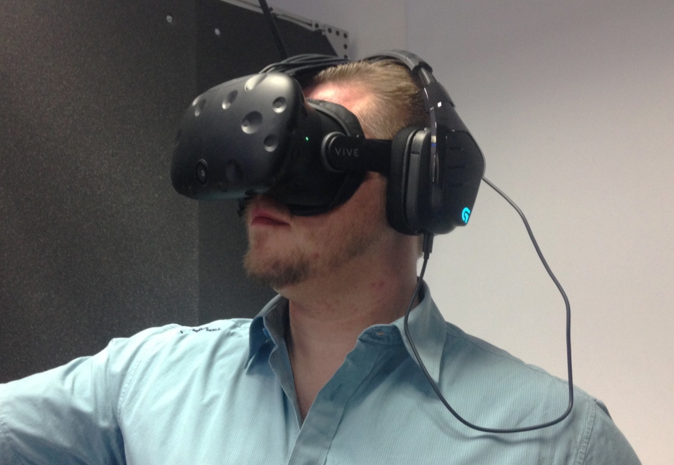 Robert Brutski demonstrates the virtual reality system at Ctrl V, a VR arcade in Waterloo, on Monday, May 30, 2016. (Alexandra Pinto / CTV Kitchener)