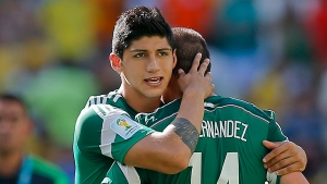 In a June 29, 2014 file photo, Mexico's Alan Pulido consoles teammate Javier Hernandez (14) after the Netherlands defeated Mexico 2-1 during the World Cup round of 16 soccer match between the Netherlands and Mexico at the Arena Castelao in Fortaleza, Brazil. (AP Photo / Eduardo Verdugo, File)
