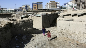 Afghan girls play near their temporary home in a camp for internally displaced people in Kabul, Afghanistan on Monday, May 30, 2016. (AP / Rahmat Gul)