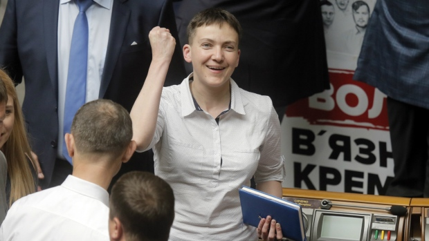 Former Ukrainian pilot Nadiya Savchenko, reacts during a parliamentary session in Kyiv, Ukraine while appearing for her first session at the Ukrainian parliament as a lawmaker in former Prime Minister Yulia Tymoshenko's party on Tuesday, May, 31 2016. (AP / Efrem Lukatsky)