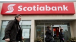 People walk past and leave Scotiabank in Toronto on Thursday, April 9, 2015. (THE CANADIAN PRESS/Nathan Denette)
