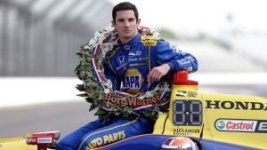 Indianapolis 500 champion Alexander Rossi on the start/finish line at Indianapolis Motor Speedway in Indianapolis, on May 30, 2016. (Michael Conroy / AP)