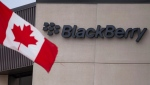 A Canadian flag flies at BlackBerry's headquarters in Waterloo, Ont., Tuesday, July 9, 2013. (The Canadian Press/Geoff Robins)