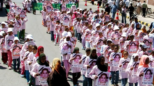 Hundreds of Egyptian girls carry posters showing Badour Shaker, who died while being circumcised in an illegal clinic in the southern city of Maghagha, Egypt, during a rally against circumcision in Assiut, Egypt, Thursday July 5, 2007. (AP Photo/Mamdouh Thabet)