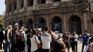 In this photo taken on Friday, April 10, 2015, people line up to enter the Colosseum, in Rome. (AP Photo/Andrew Medichini)