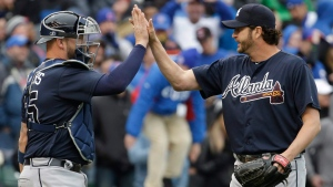 Atlanta Braves relief pitcher Jason Grilli, right, celebrates with catcher Tyler Flowers, in Chicago, on Sunday, May 1, 2016. Grilli has been traded to the Toronto Blue Jays. (AP Photo/Nam Y. Huh)