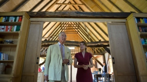 Britain's Prince Charles is accompanied by Aura Woodward, the executive director of The Prince of Wales Foundation in the Transylvanian village of Viscri, Romania, Wednesday, June 1, 2016, during the opening of a training center to encourage conservation, farming and sustainable development in Romania. (AP Photo/Andreea Alexandru)