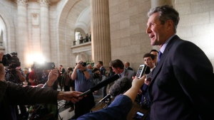 Manitoba Premier Brian Pallister speaks to media after his first provincial budget is read in the Manitoba Legislature in Winnipeg, Tuesday, May 31, 2016. (John Woods/The Canadian Press)