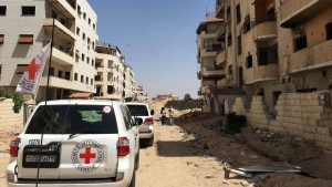 This image released by the International Committee for the Red Cross shows the first humanitarian aid convoy in Daraya, Syria on Wednesday, June 1, 2016. (ICRC via AP)