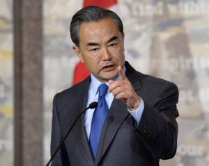 China's Minister of Foreign Affairs Wang Yi responds to a Canadian journalist's question during a press conference with Canadian Minister of Foreign Affairs Stephane Dion (not shown) on Wednesday, June 1, 2016 in Ottawa. (Justin Tang / THE CANADIAN PRESS)