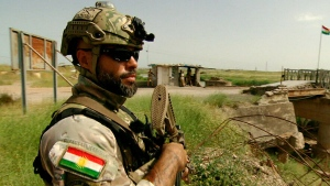 CTV News cameras capture a Canadian soldier wearing a Kurdish flag on his uniform in Iraq.